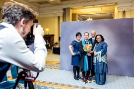 New Fellow and family posting for photos at the Admission Ceremony 2018