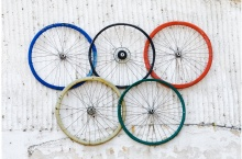 Photograph of different coloured bicycle wheels