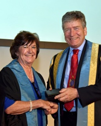 Professor Judith Adams being awarded the RCR Gold Medal by Dr Giles Maskell, RCR President