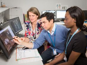 Clinical oncologists planning patient treatment