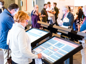 Delegates review e-posters at RCR18
