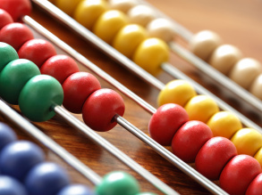 Close up image of colourful abacus beads