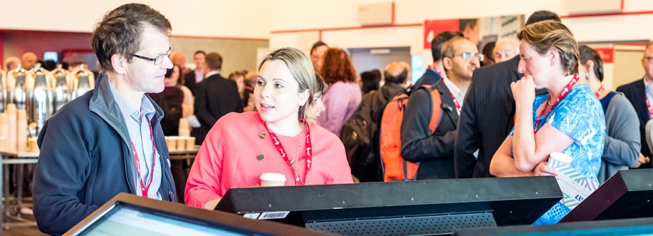 Conference delegates looking at e-posters
